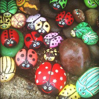 Rock garden ~ painted lady bugs in my garden.