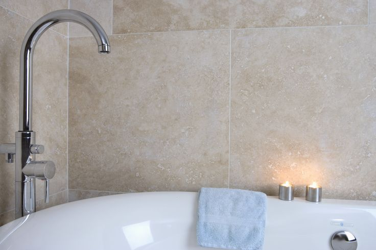 Ivory Honed and Filled Travertine in the bathroom.