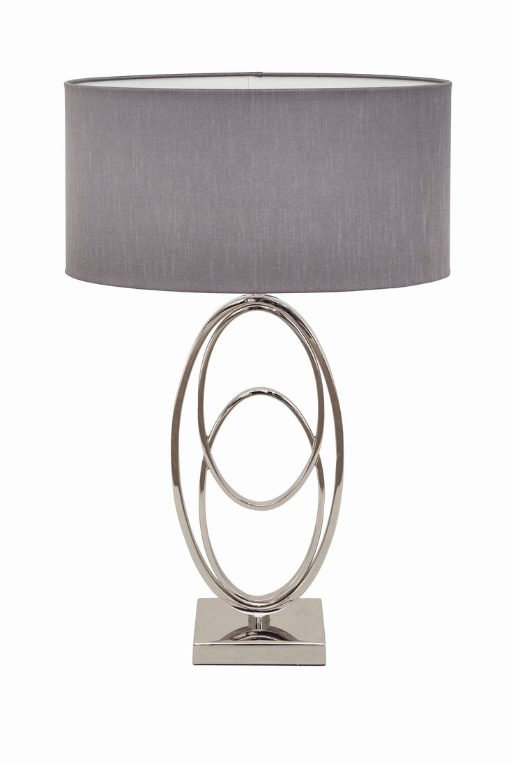 The Oval Rings Nickel Table Lamp by RV Astley boasts a frame finish in polished chrome, with a light shade. Part of the Oval Rings range, this beautiful floor lamp is the perfect compliment to a minimalist living room.