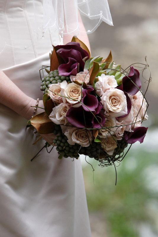 Bouquet including calla lilies, Honeymoon roses, succulents, berry and vine