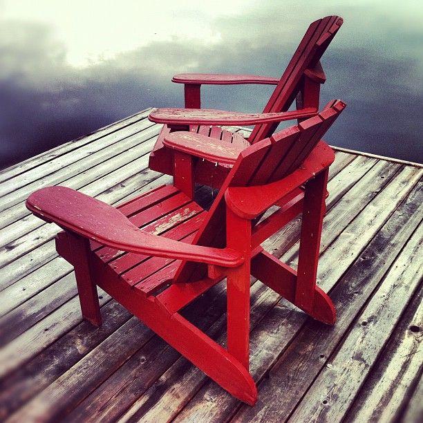 Muskoka Chairs on the dock in beautiful Muskoka, Ontario. Instagram by ruthtaitphotos