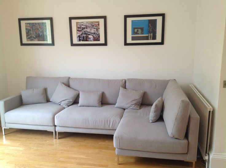 Bespoke Ole standard and bespoke sofa sections to create a right handed armless sofa corner unit. Further bespoking including having just one base cushion on the right handed sofa and no buttoning on the bases. We added metal legs, sourced locally, and covered in COM ( J Brown Harbour 35 dove FR).