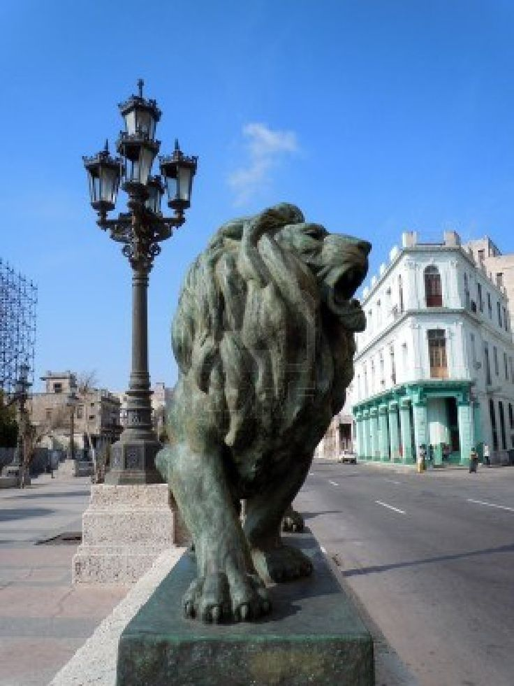 Bronze lion and street light in Havana, Cuba