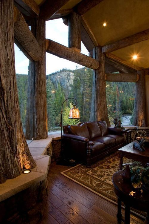 cabin in the mountains. This view blew my mind. Love the logs and design of windows. That was one thoughtful architect!