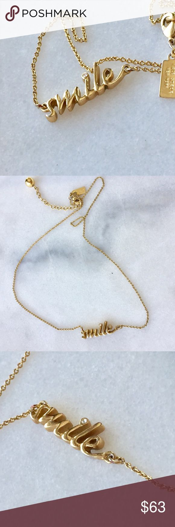 "♠️Kate Spade ""Smile"" Gold Toned Word Necklace♠️ Spread happiness wherever you go! Slight tarnishing on the back of the ""smile"" pendant, but the front is in great condition. Cleaned ultrasonically just for you✨ kate spade Jewelry Necklaces"