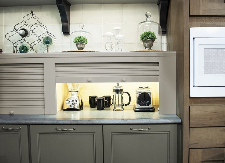 Beautiful visual provided by these tambour storage units. #KBIS2015 #wellborncabinet
