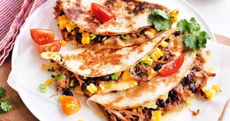 Take a few shortcuts with these deliciously easy, pulled pork and bean quesadillas.