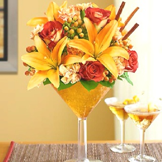Centerpieces - like the martini glass concept... but definitely different colors to be used.. more bright