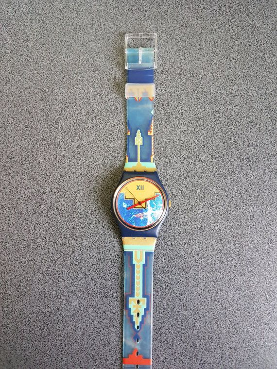 Conditio: 99% NEW, Never Worn This watch is Part of a 200 Swtach Collection! Unique Models Check my other Swatch section for more models:  https://www.etsy.com/shop/InstaAntiques?ref=l2-shopheader-name&section_id=20319988     1991 Vintage Swatch Watch Gold Flamingo GN114 Metal Flex band.  Water resistant 30 meter / 100 Feet.  Diameter case 33 mm.  The watch looks New.   Beautifull preserved Swtach Model!   All watches exposed are part of a big collection...