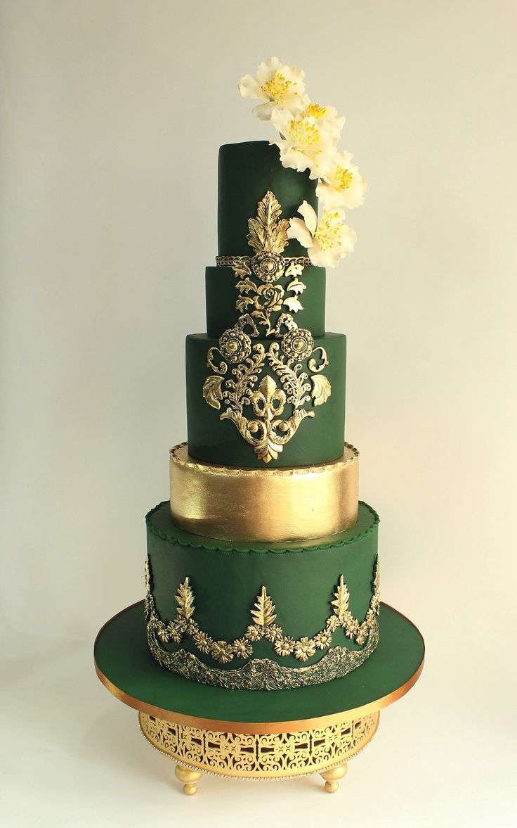 A gallery of fondant and gum paste wedding cakes from cake decorators around the world inspired by the color green.