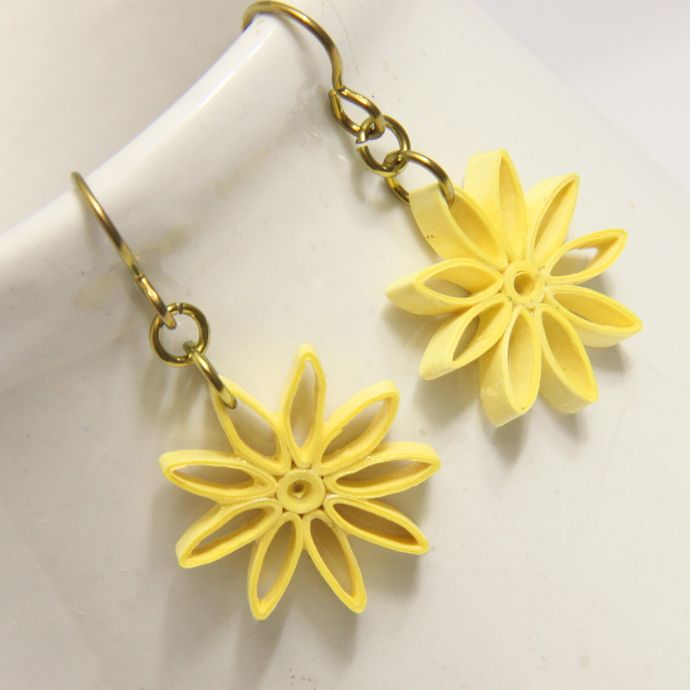 Yellow nine pointed star paper quilled earrings with niobium findings - Honey's Quilling