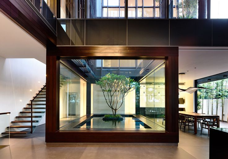 Vertical Court is a minimalist house located in Park, Singapore, designed by HYLA Architects. The project consists of a courtyard on two levels sitting in the center of this semi-detached house. (3)
