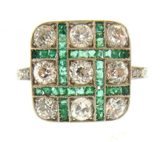 Art Deco Emerald & Diamond Ring. Square cut emerald grid surrounding solitaire cut diamonds.  Gorgeous!