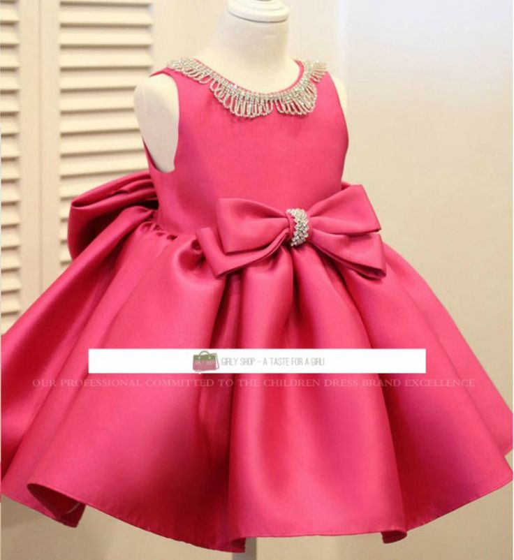 Rhinestone Applique Dress---Made To Order - High Quality Sleeveless Knee Length Big Bow Back Beautiful Rhinestone Neckline Applique Little Girl Dress Available from 3 months until 12 years old Material: Polyester fiber, cotton lining, tulle mesh, satin Color: Pink Bubblegum Please do compare your  little girl measurements with our size chart before deciding her size or you may leave a note your little girl's height, bust and waist measurements so we can process it and send you the right…