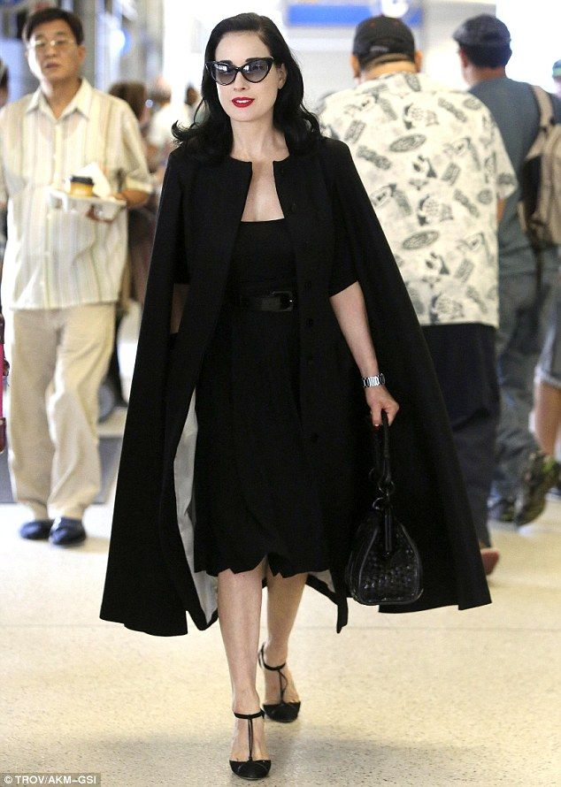 Even at the airport, Dita is all fucking style.