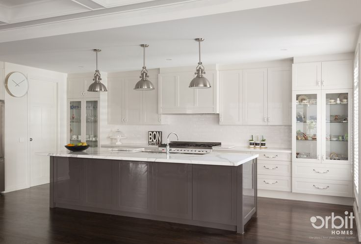 Hamptons Style Kitchen With A Chic And Modern Finish. Pendant Stainless  Steel Lights With Two Tone Cabinetry, Is Finished Off With A Matte Calacattu2026