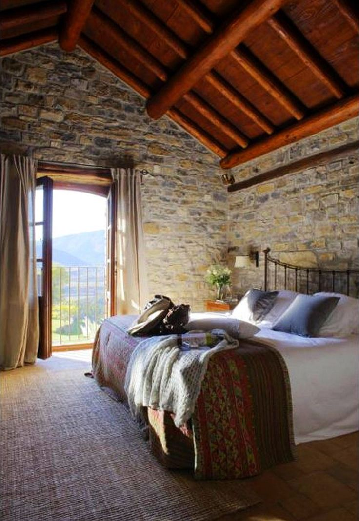 rustic feel in the bedroom.  exposed beam ceilings.  home decor and interior decorating ideas.