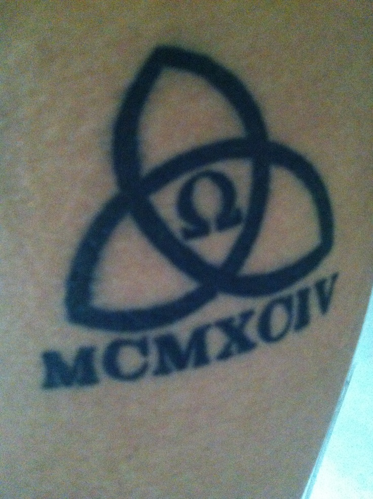 Represents 03/24/1994. The three is represented by the trinity (in the name of the father , the son , the Holy Spirit) The 24 is represented by the Omega which is the 24th letter in the Greek Alphabet . The Roman numerals is 1994