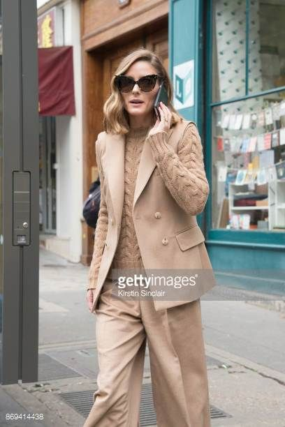 Model and Socialite Olivia Palermo wears a Balmain sweater Max Mara jacket sunglasses and trousers day 3 of Paris Womens Fashion Week Spring/Summer...