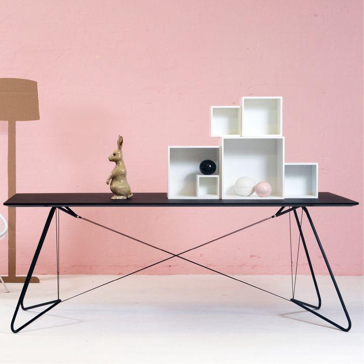 """Smukt bord """"On a String"""" fra OK Design. Bordet har en let konstruktion i rør og snore, samt en bordplade lavet i Linoleum."""