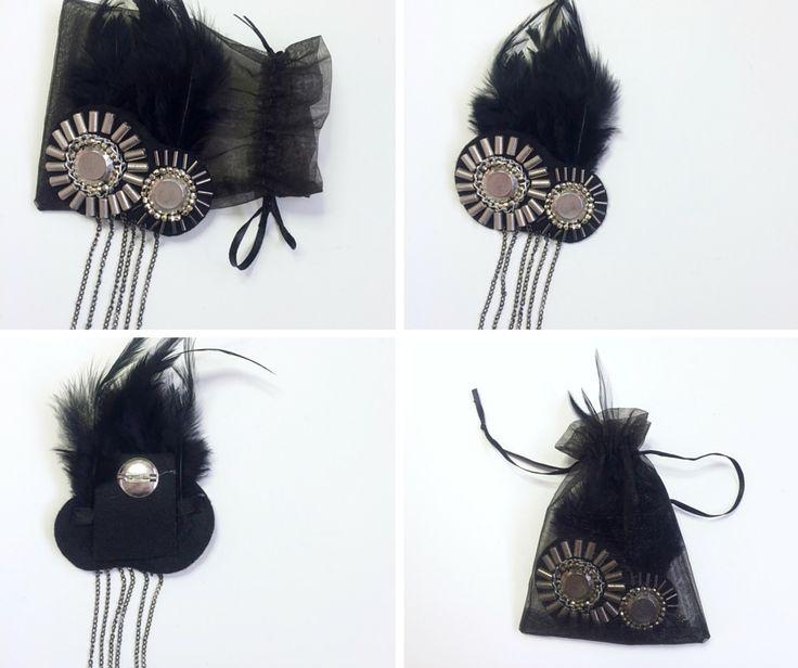 Handmade brooch made of felt, feathers, metal chains and beads. #handmade #diy #brooch