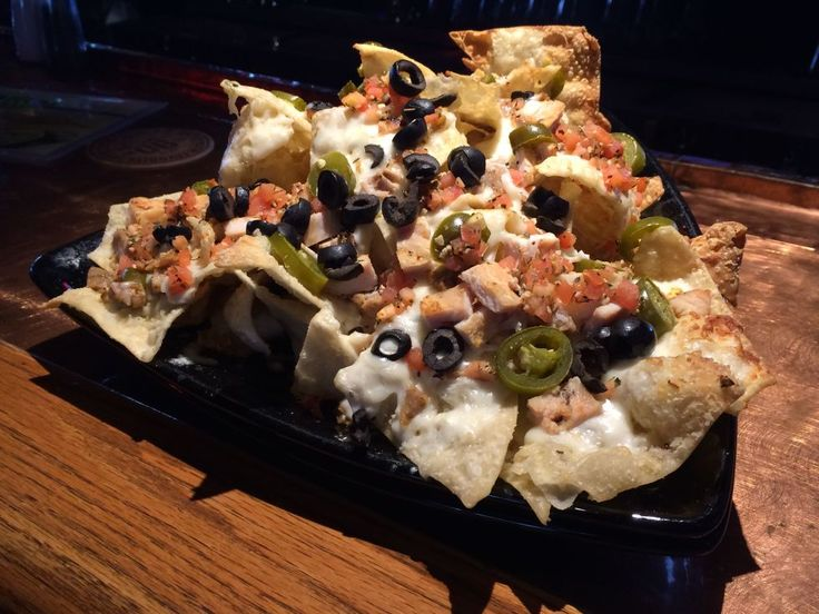 Italian Nachos at Firehouse Grill      Ammon Deep-fried wontons are pretty tasty on their own, but imagine them with melted mozzarella, slices of Italian sausage and chicken, herbed tomatoes, jalapeños and a drizzling of Alfredo sauce. Yes, please!