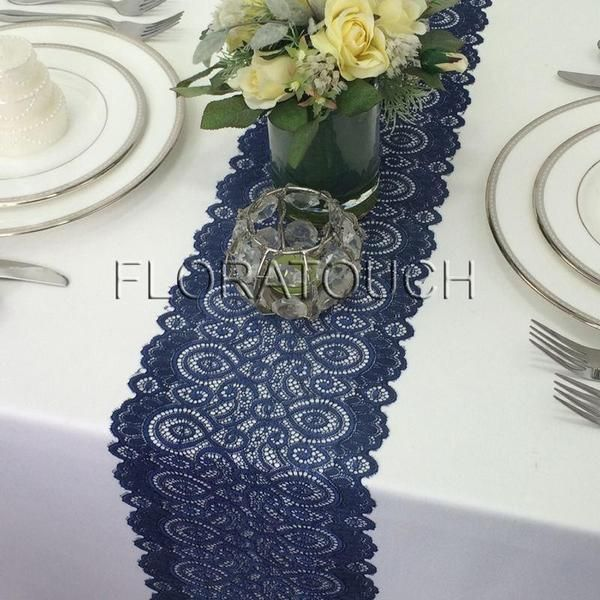 """These navy lace table runners are a favorite choice for rustic or vintage themed weddings. Nothing speaks to romance like tulle and lace. Add some candles and a few small flower vases in your wedding color, you have an instant wedding wonderland.   Size: approx 7"""" wide by the length you choose.   - If you have 60"""" table, 72"""" length runner will give you about 6"""" overhang either end. If you have 72"""" or longer table, you will need at least 84"""" or longer runner in o..."""