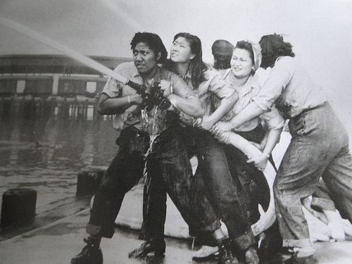 """It was meant to be a publicity picture--it wasn't taken at Pearl Harbor, but still shows sacrifice that was made by women & their participation in the war effort. It is the beginning of the new woman. Women of World War II aren't going back to their traditional ways. They are going to be able to do the jobs that they've been denied for such a long time. But it wasn't taken on December 7th""""…"""