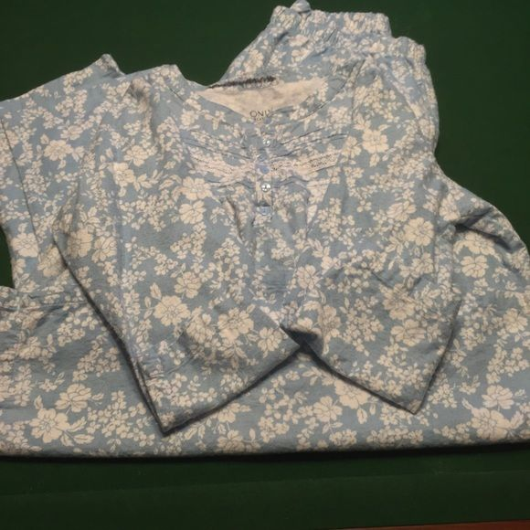Almost new  cozy and cute pajama set. Never worn pajama set, but have a name marked out  at the top of each piece.  They have been washed also. These are super cute and cozy pajamas.  Comes from a smoke free home. Intimates & Sleepwear Pajamas