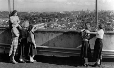 Pelaco employees overlooking Richmond from the roof of the factory