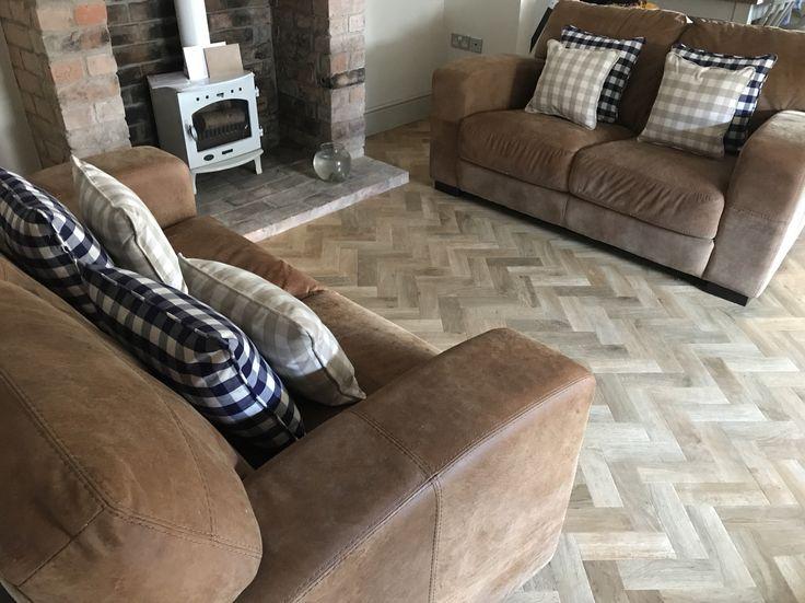Tan sofas - navy cushions adding colour to kitchen
