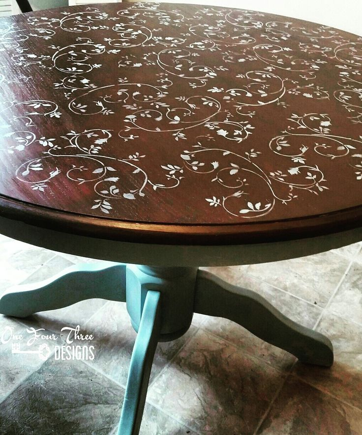 Round kitchen table makeover using General Finishes Antique Walnut Gel Stain for the top and Persian Blue Milk Paint for the bottom and stencil design.  | By One Four Three Designs