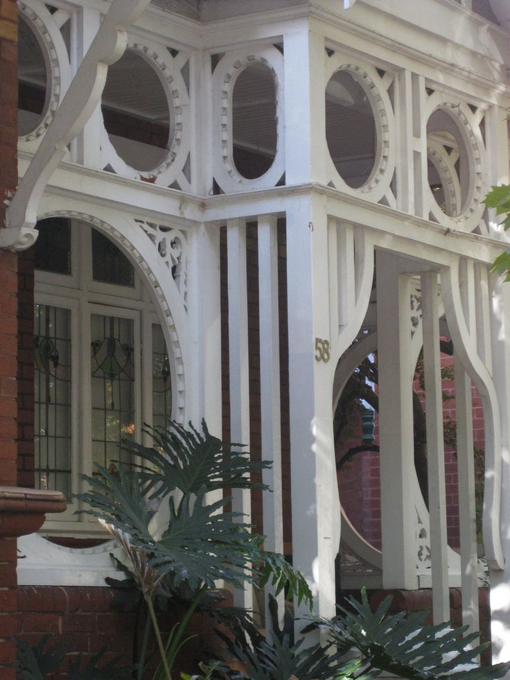Frothy Fretwork. This verandah of a Queen Anne villa in a leafy tree lined street of the Melbourne suburb of Elwood is almost entirely enclosed by ornate lace like fretwork.