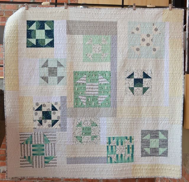 "Minty Churn Dash blocks ""Dance"" in this modern quilt by Leanne of She Can Quilt.:"