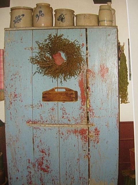 blue cup board w/wreath salt, glaze crocks w/ blue swirls & a untincel tray