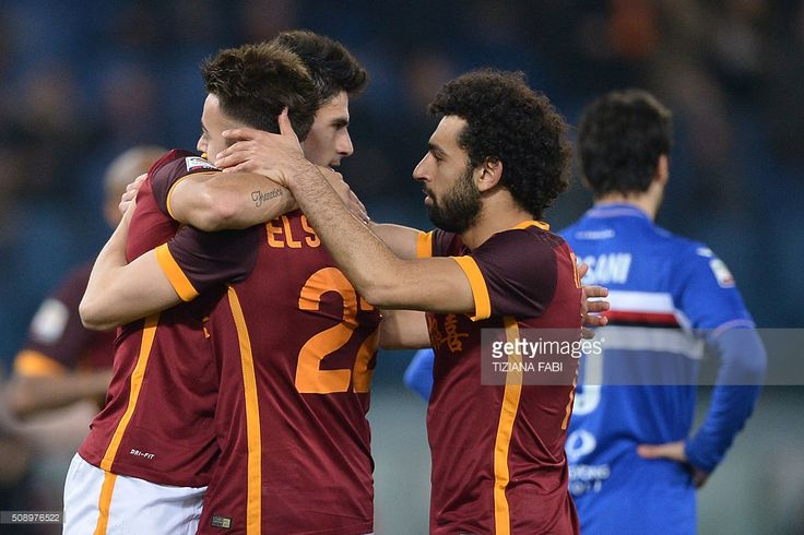 Roma's midfielder Diego Perotti (L) celebrates with teammates Roma's forward from Italy Stephan El Shaarawy and Roma's midfielder from Egypt Mohamed Salah (R) after scoring during the Italian Serie A football match AS Roma vs Sampdoria at the Olympic Stadium in Rome on February 7, 2016. / AFP / TIZIANA FABI