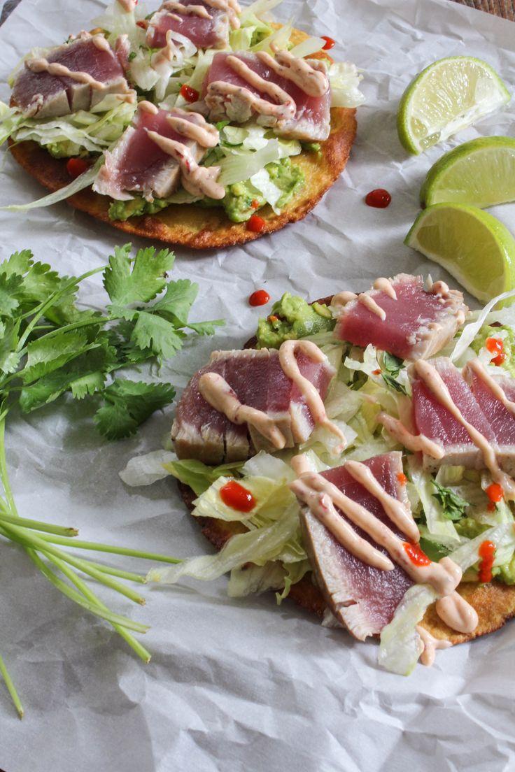 Seared Tuna Tostadas are made with fresh seared yellowfin tuna, crispy corn tortillas, guacamole, lettuce, and chipotle crema.