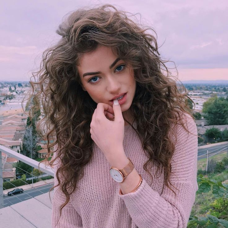 Long curly voluminous gypsy hair with tapered ends