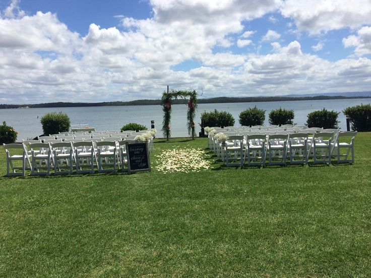 Sarah's #beautiful #outdoor #wedding #ceremony @Raffertysresort #whitefoldingchairs #babysbreath #masonjars #rosepetalaisle #rusticArch