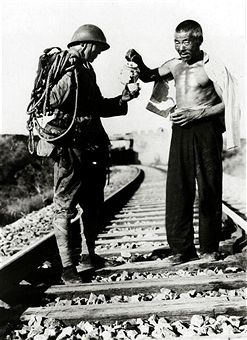 War and Conflict, 2nd Sino-Japanese War, (1937-1945), A Japanese railroad guard is refreshed by a cup of tea from a friendly chinese near Tientsin, Northern China, Following the two countries conflict at the end of the 19th century, further hostilities developed after the Manchurian Incident of 1931, the Japanese Army occupied Manchuria and set up the puppet state of Manchukuo - pin by Paolo Marzioli