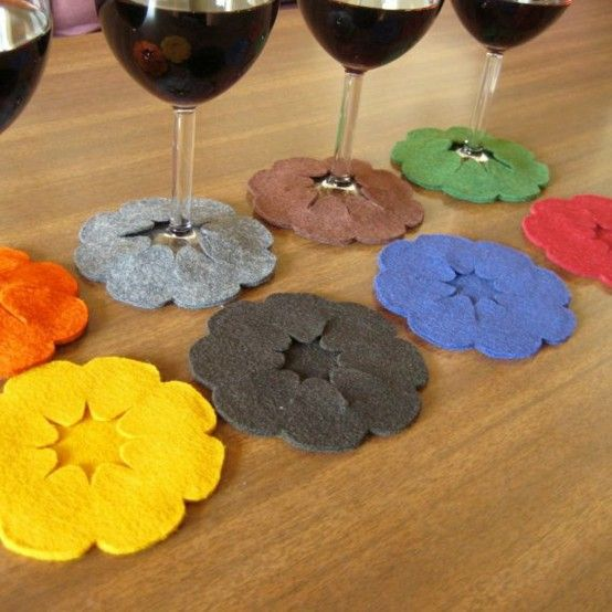 Coasters that attach to your glass. Guests won't wonder which glass is theirs and you don't have to worry about coasters. I'm not sure about felt, but you could do this with any fabric and add sparkles :-)