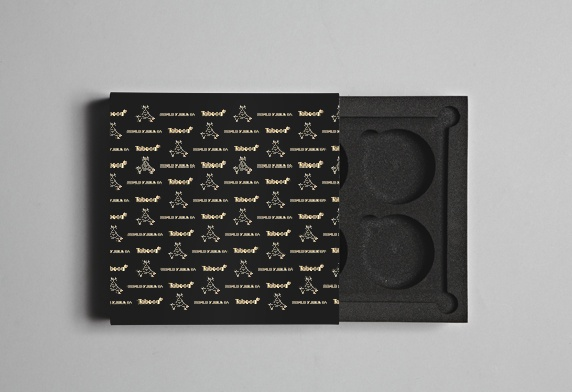 Snus Promotional Packaging. This piece of packaging was commissioned by Norwegian snus manufacturer Taboca to promote its new premium tobacco ranges.  We created the outer pack from black acrylic sheet, foil blocked and heat bent to shape. The interior was produced from high-density black foam that was cut and routed to create recesses for the snus tins. #snus #graphicsonanysurface