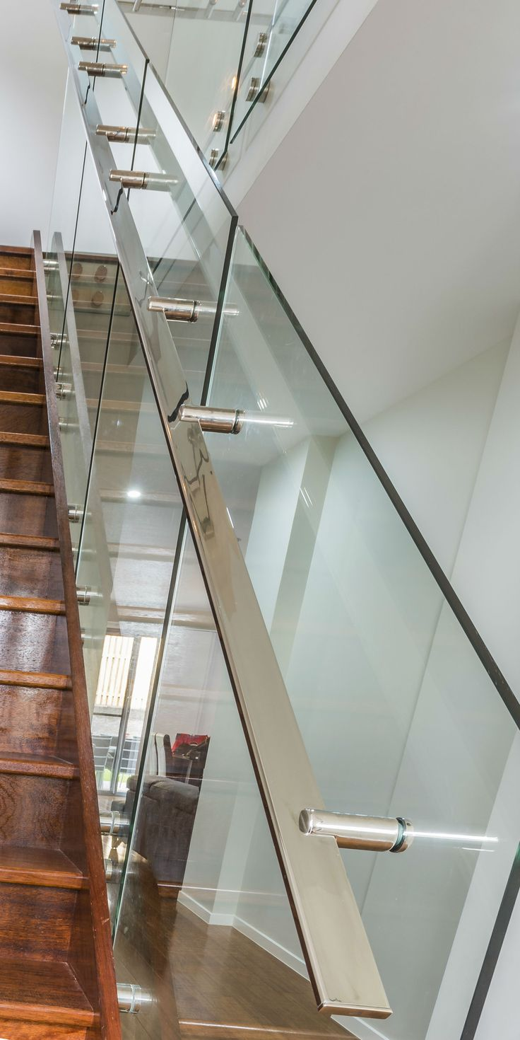Glass balustrade with stainless steel mirror polished handrails and fittings                                                                                                                                                                                 More