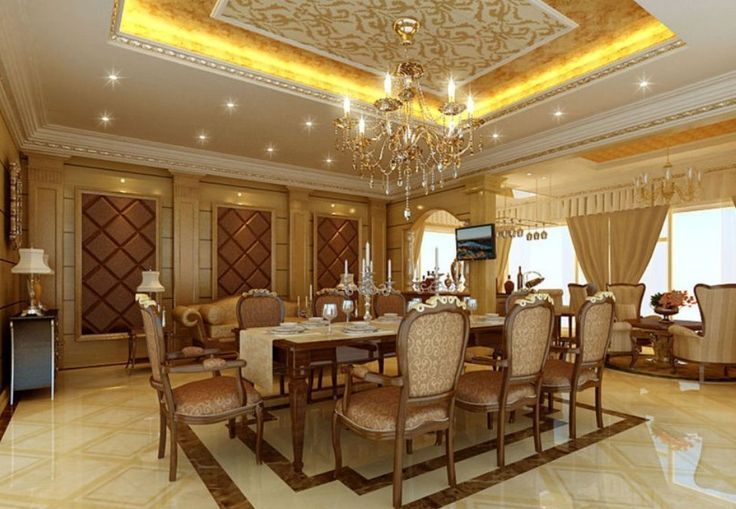 Gold ceiling with cove lighting and crystal chandelier for Luxury dining room design