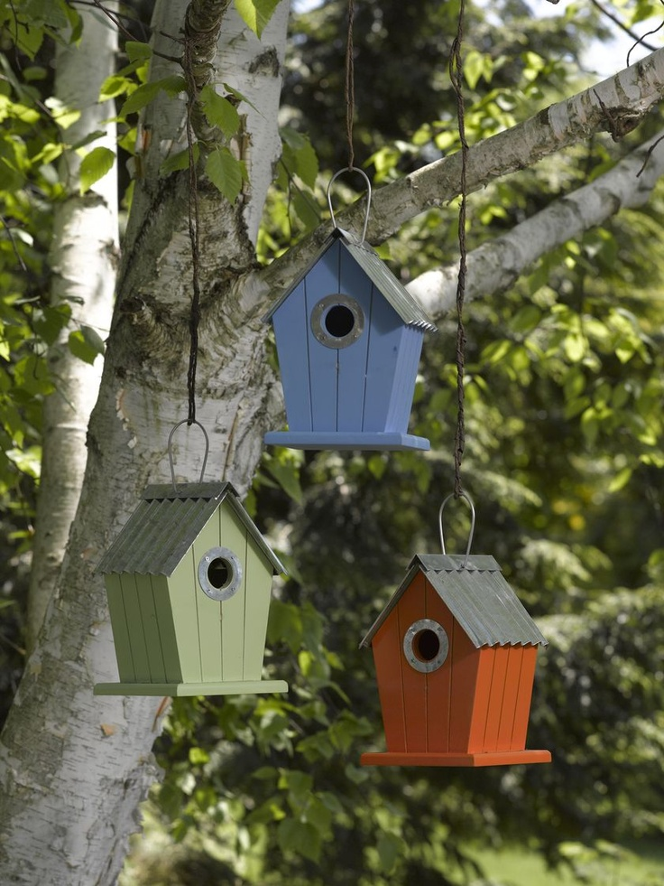 "Cottage Birdhouses, Set of 3: Brightly colored with galvanized metal roofs, these birdhouses have 1-1/4"" entrance holes, perfect for nuthatches, titmice, wrens and chickadees. Made from pine with a double-layer protective coating. Metal rings around the entrances deter gnawing predators, and clean out doors on the back make end of season housekeeping easy."