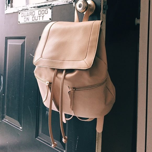Forever 21 backpack purse Forever 21 cream backpack purse! Super chic & sporty. Cute for traveling too Forever 21 Bags Backpacks