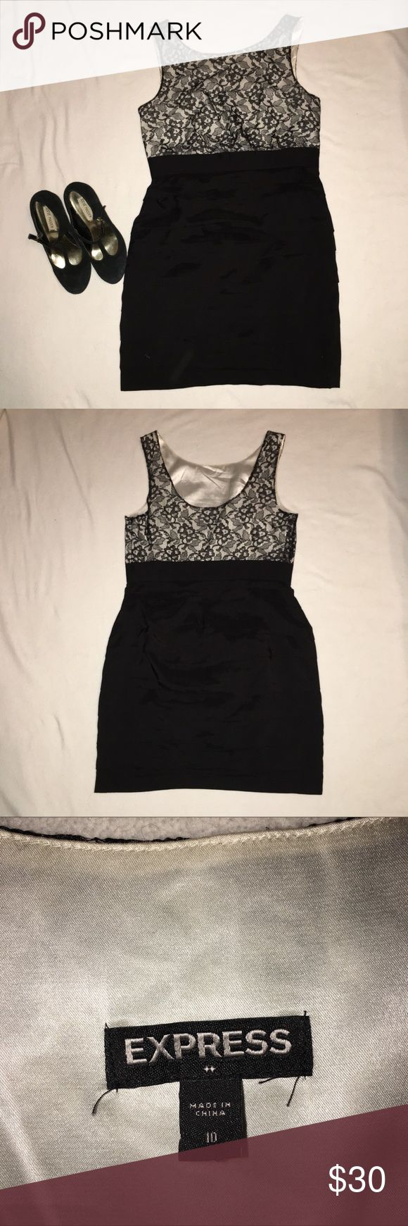 Express ruched dress size 10 Black lace on top with black ruching on the bottom. Very figure flattering,especially if you are more curvy. Side zip closure. Size 10. Hits just above the knee. Express Dresses