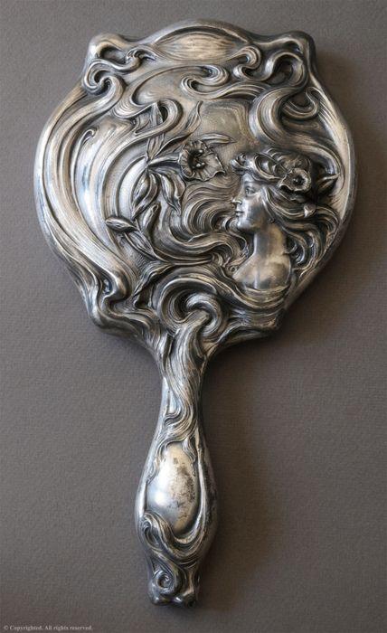 an art nouveau hand mirror
