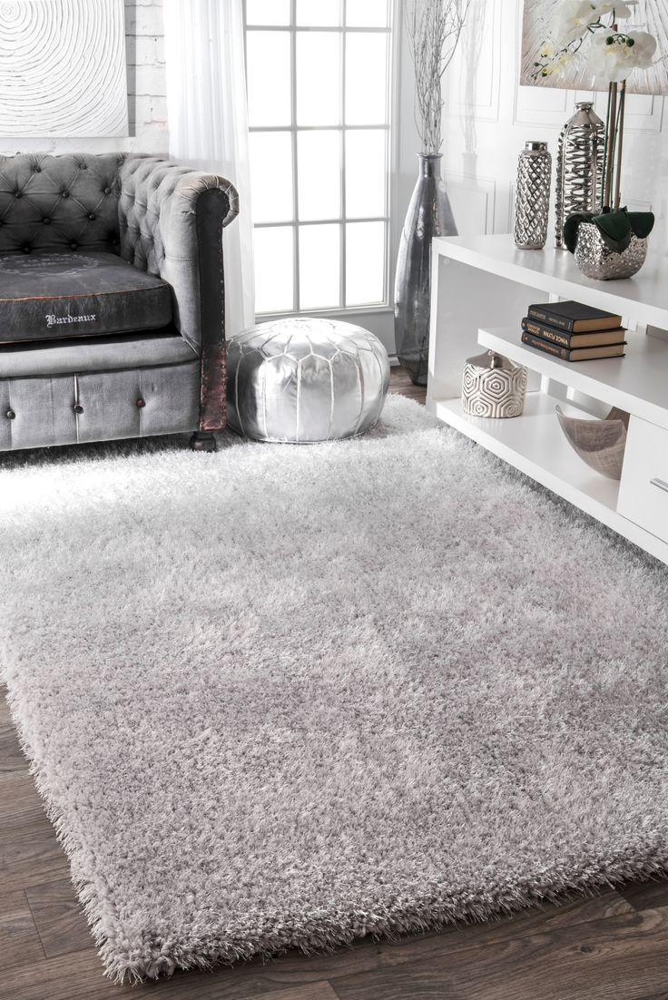 Bring simple luxuries into your home with this hand-tufted rug. This rug is woven from Polyester into a transitional pattern with hand-carved details. This rug evokes a spa-like aura in any room throughout your home.