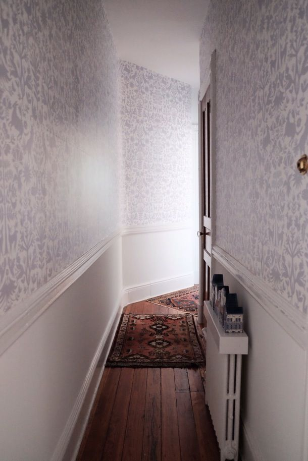 """""""My proudest DIY in the apartment is my Hygge & West wallpapered hallway; it was such a narrow, dead space before, but now I just have a huge a grin whenever I walk through it."""""""